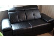 Fantastic condition black leather 2-seater sofa recliner